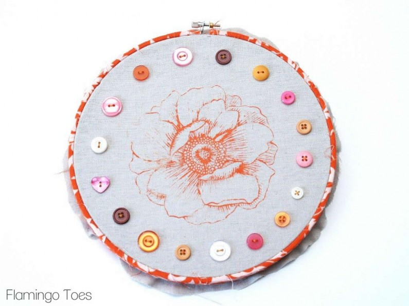 Sewing Buttons on Hoop Art