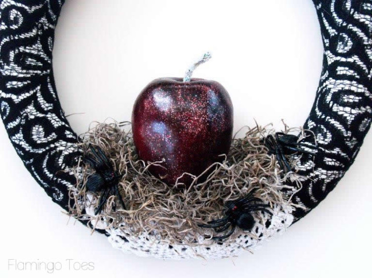 Adding apple to wreath