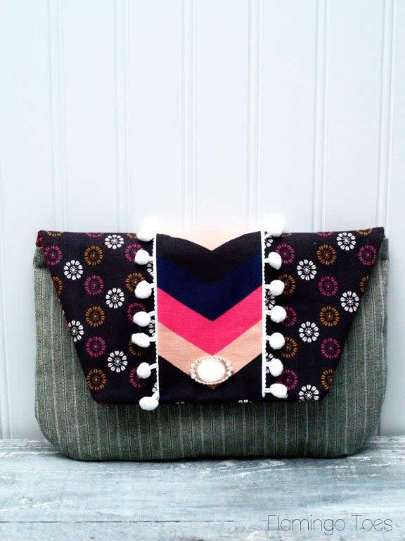 pom pom fold over clutch