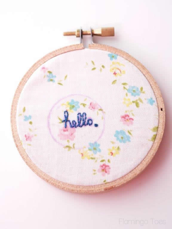hello embroidered on fabric