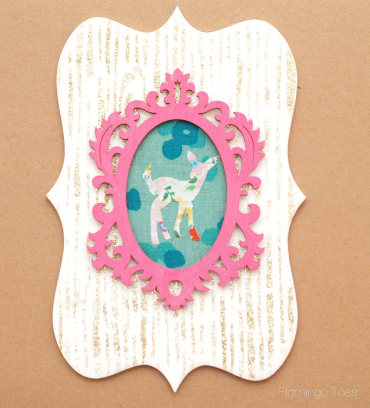 fabric deer on glitter wood grain background
