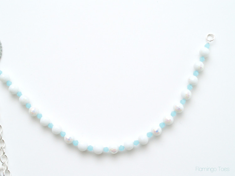 white and blue bead strand