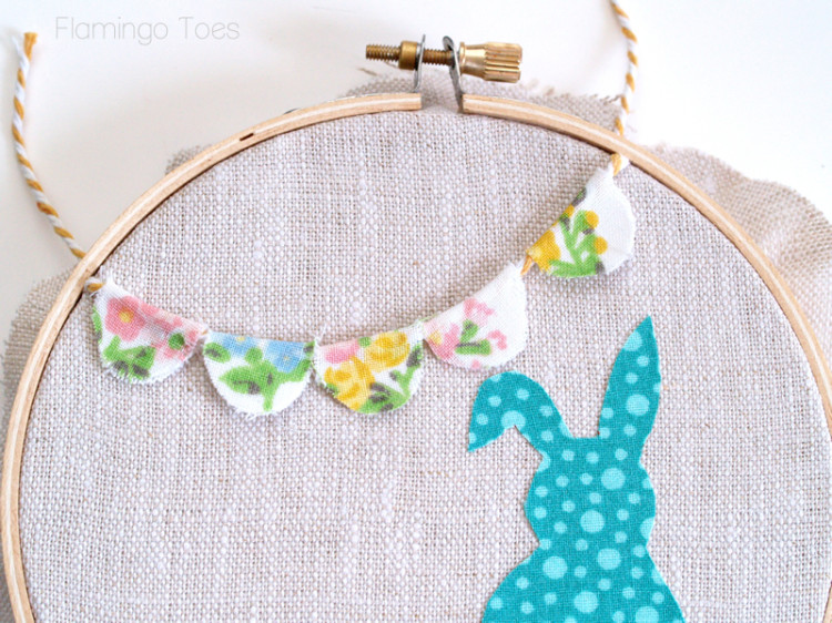 putting fabric and bunting in hoop