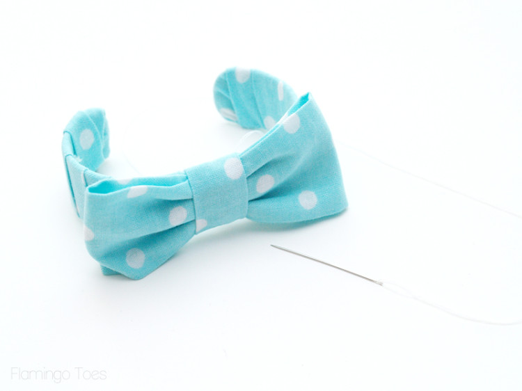 sewing bow to bracelet