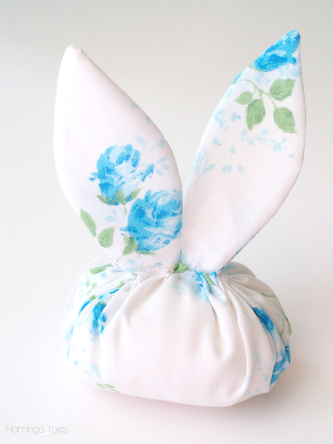 sewing ears to bunny