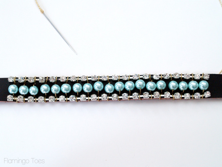 sewing rhinestones and pearls to cuff