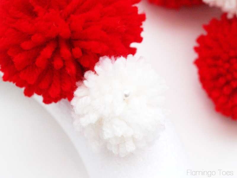Adding Pom Poms to Wreath