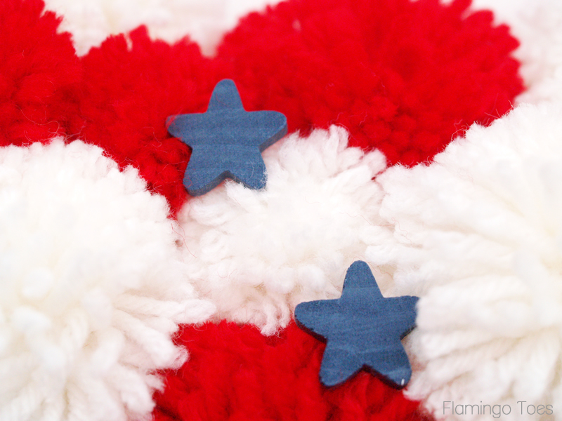 Pinning stars to wreath