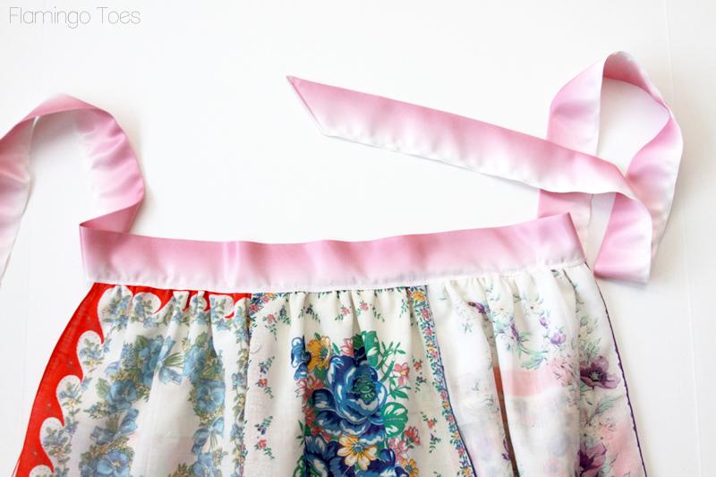 sewing ribbon to apron