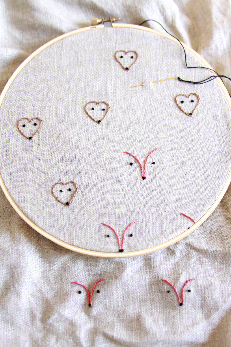 embroidered woodland faces