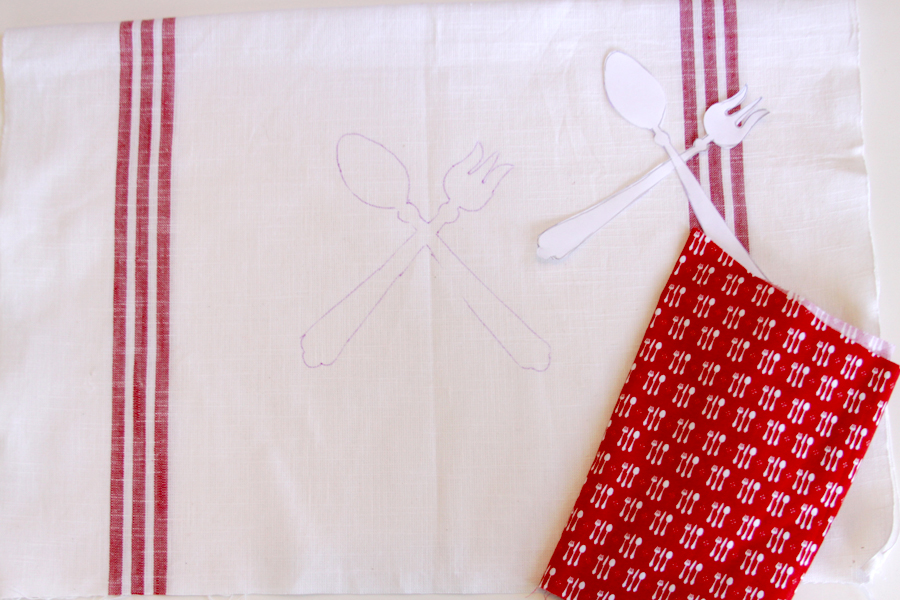 tracing silverware on dishtowel