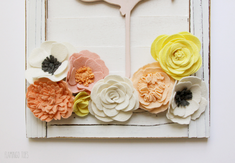 Gluing Felt Flowers to Shutter
