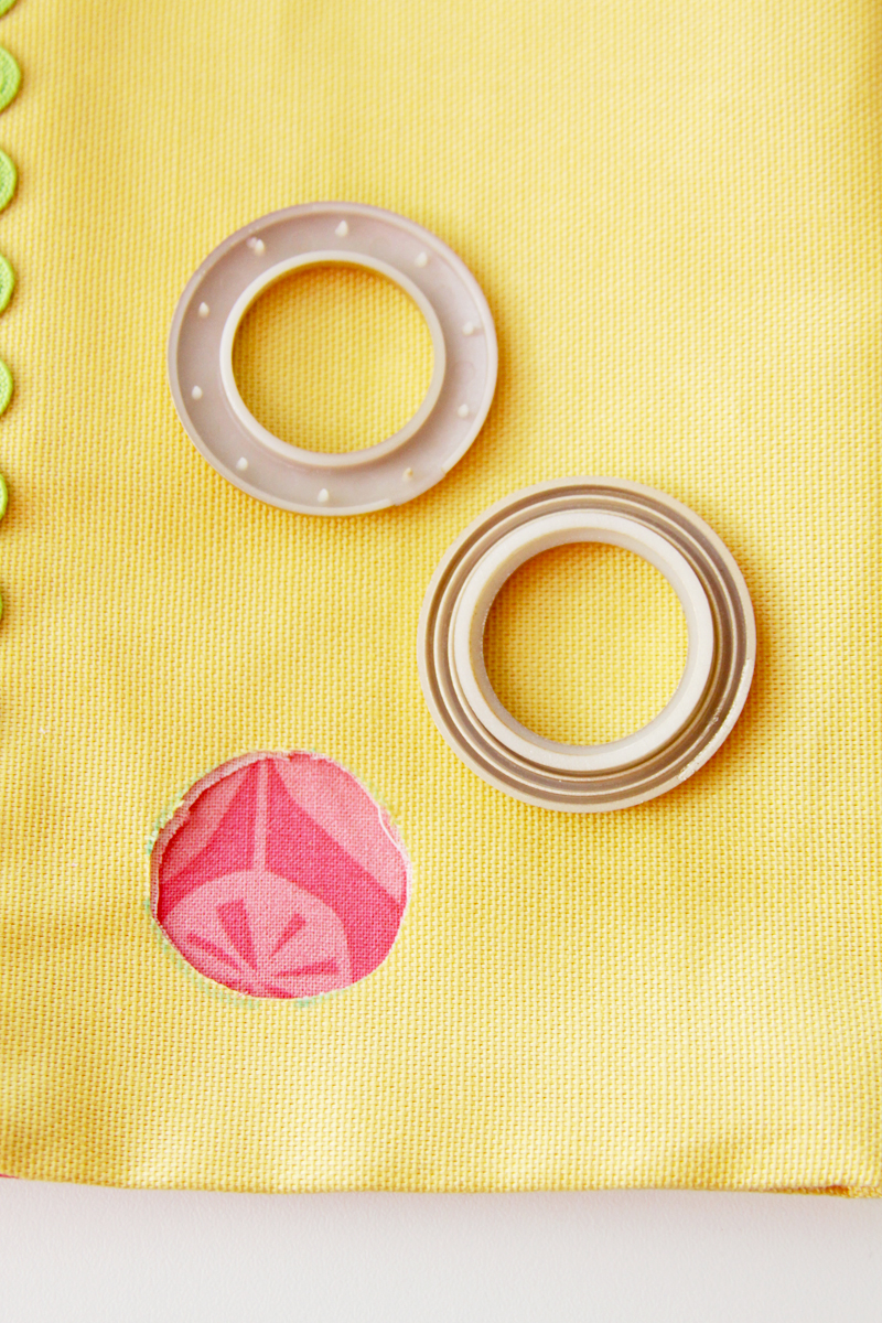 Cut circle in fabric for curtain grommet