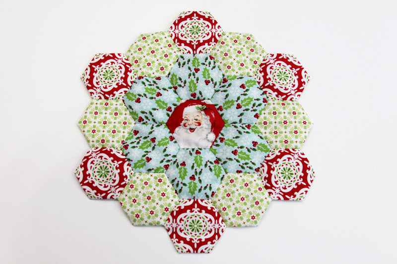Paper Pieced Hexagons in Christmas Fabric