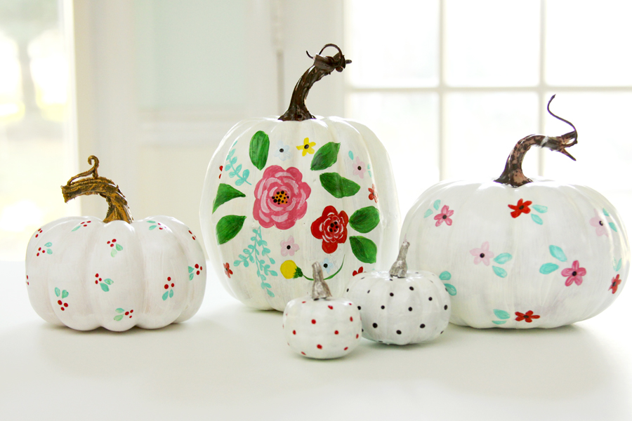 Cute and colorful painted pumpkins Flower painted pumpkins