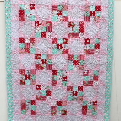 Scrappy Nines Baby Quilt in Vintage Adventure