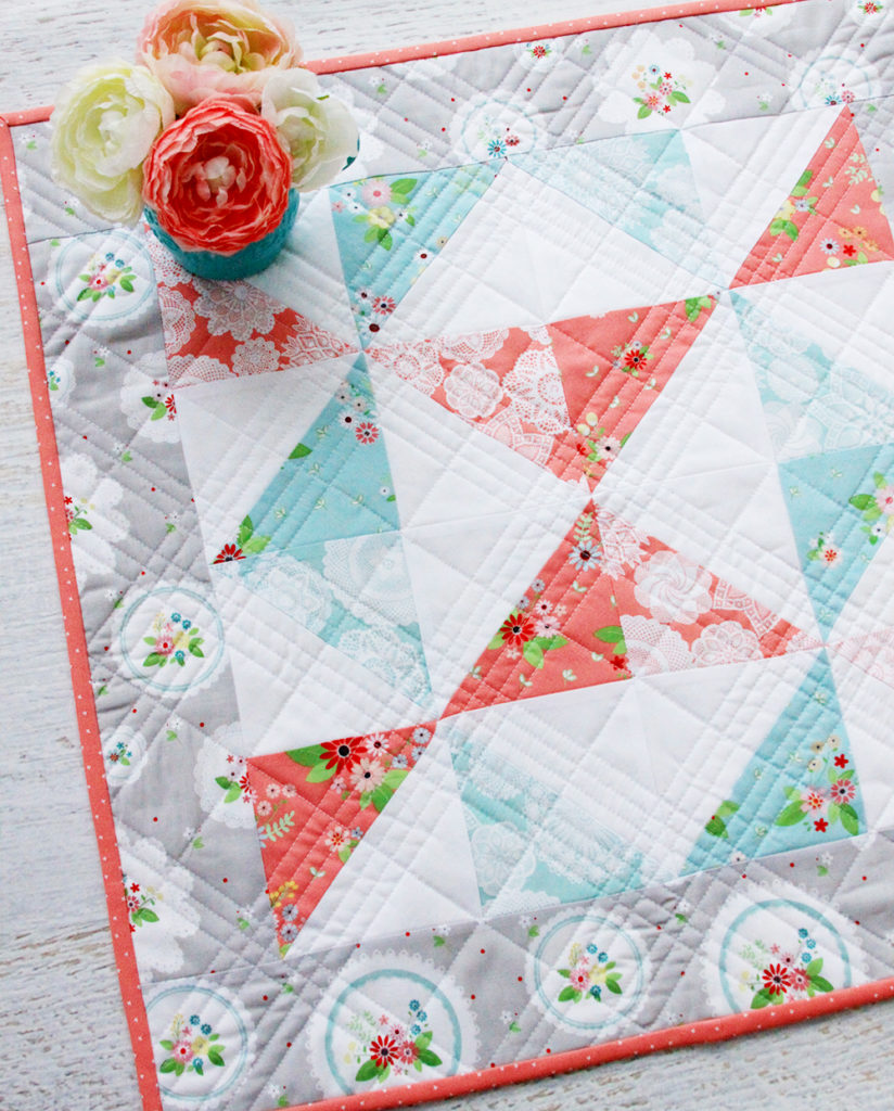 Vintage Paths Mini Quilt - Quick and Free Mini Quilt Pattern! | 2019 Top Ten Quilting and Sewing Projects! by popular Tennessee quilting blog, Flamingo Toes: image of a vintage paths pinwheel mini quilt.
