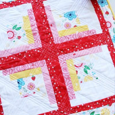 Colorful Log Cabin Mini Quilt in Flutter and Shine Fabric