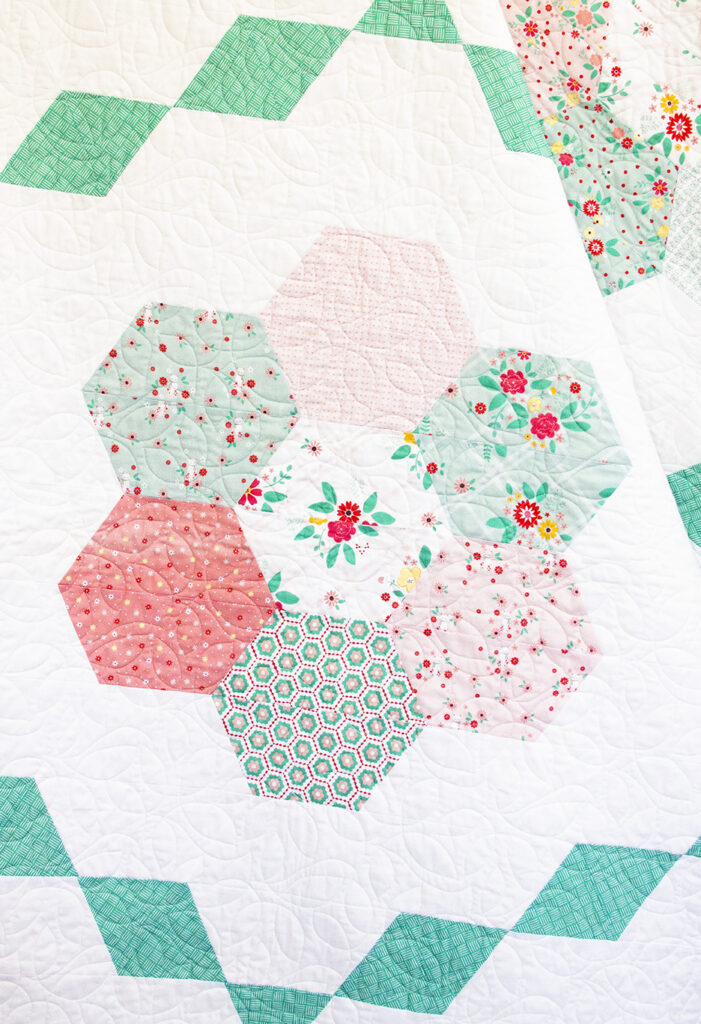New Quilting Templates on the Way! by popular Tennessee quilting blog, Flamingo Toes: image of quilt with hexagon quilt blocks.