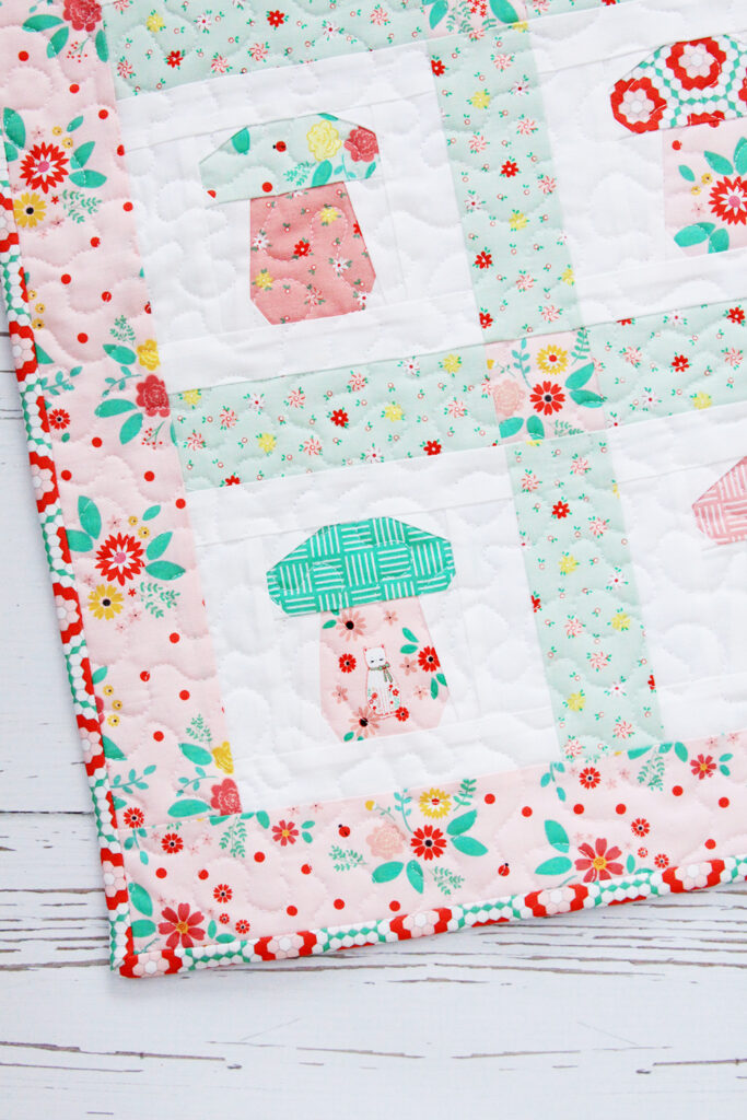 Mini Mushroom Quilt featured by top US quilting and sewing blog, Flamingo Toes.