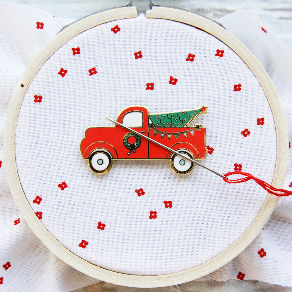 Happy Little Things Quilt Block 4 by popular quilting blog, Flamingo Toes: image of a Christmas Needle Minder enamel vintage truck Christmas pin.