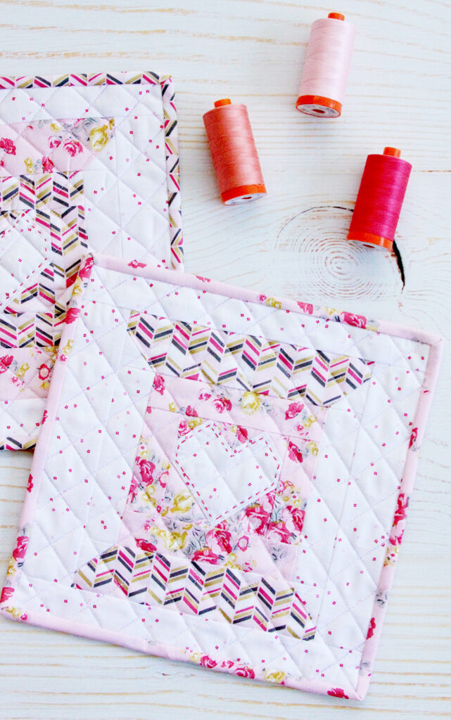 Love to Stitch Quilt Block pattern made of a sweet thread spool and heart